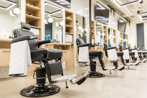 Barded Goat Barber Chairs inside Arlington Location
